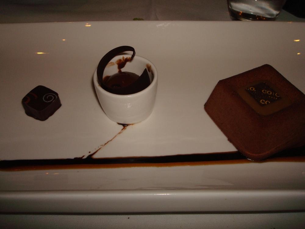 dark chocolate mousse / vanilla crème brulee / salted caramel / crispy chocolate pearls / brownie / chocolate sorbet / cinnamon toffee bon bon